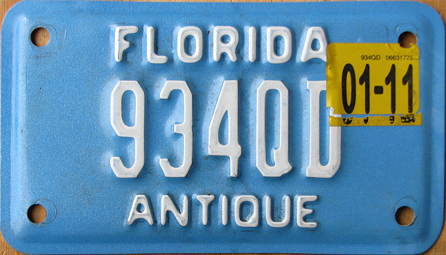 October 2015 expiration (aapears to be a fake sticker)? on University of Central Florida plate & Florida 5 Y2K